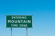 Road sign with Mountain time zone, New Mexico