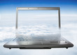 Laptop with a heavenly landscape on the screen.Laptop soars into