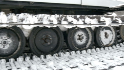 Side view of the snow back hoe truck