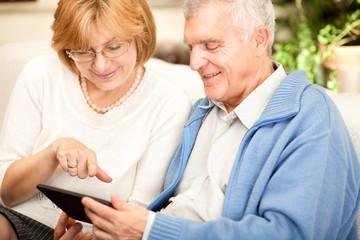 Senior couple using tablet PC