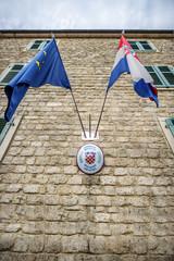 MONTENEGRO, KOTOR - JULY 17, 2014: Flags in the croatian consula