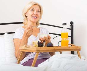 mature woman enjoying healthy breakfast