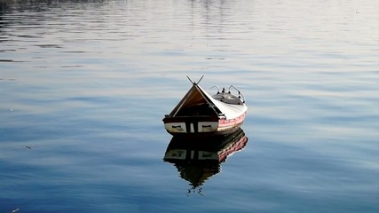 Small fishing boat floating on the water
