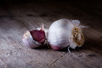 organic garlic with a clove on old wood