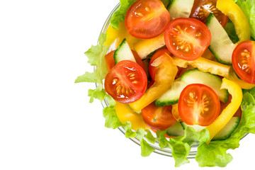 Bowl with fresh vegetable salad. Isolated on white