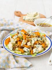 salad with pear, pumpkin, nuts and blue cheese