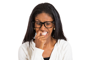 nervous woman with glasses biting fingernails white background