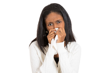 sick young woman with allergy, germs, cold, blowing nose