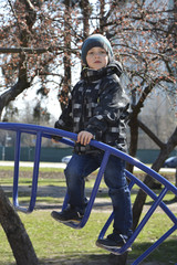 Spring boy playing on the playground.
