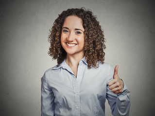 woman student being excited giving thumbs up hand gesture