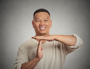 confident business man showing time out gesture with hands