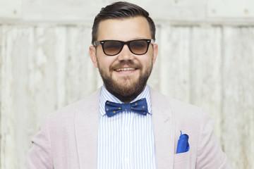 Young men smiling in fancy suit
