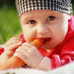 Baby eats carrots
