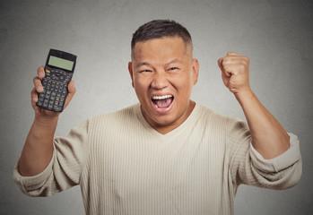 Happy man with calculator winner money reward grey background