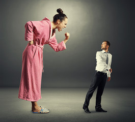 woman shouting at small scared man