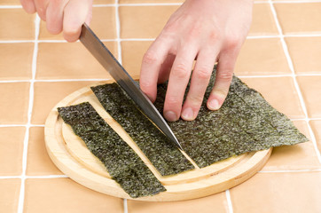 cutting seaweed for sushi