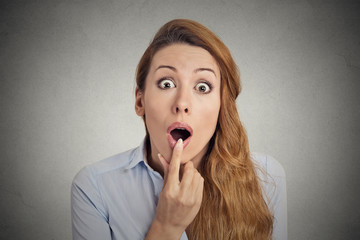 Surprised astonished woman with open mouth grey background