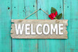 Welcome sign with rose hanging on door - 76080180