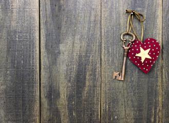 Skeleton key and star hanging on wooden door