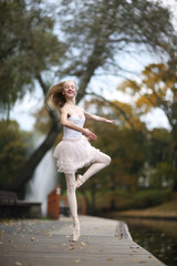 Ballerina whirling on the toe in the park