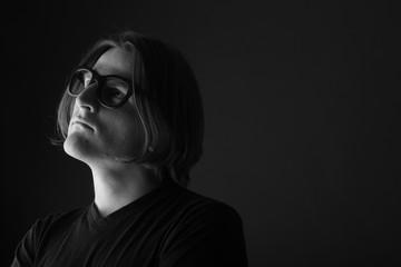 Thoughtful man in eyeglasses portrait, monochrome