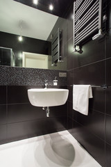Modern black tiled bathroom