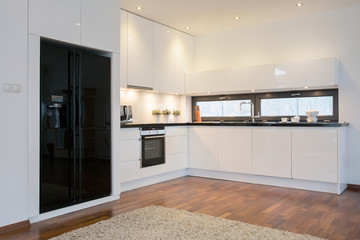 Black fridge in bright kitchen