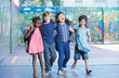 Happy kids embracing and smiling in the elementary schoolyard. I - 76082154