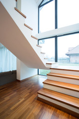 Wooden stairway in detached house