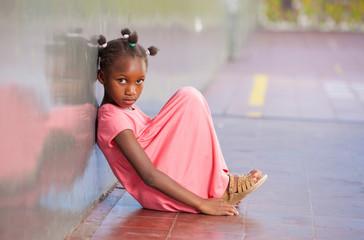 Primary school afro american girl frustrated in schoolyard