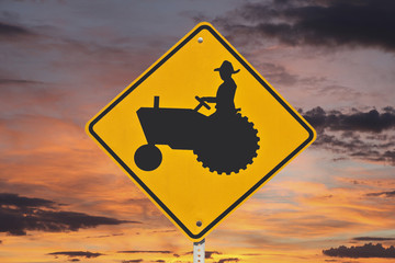 Farmer Tractor Crossing Sign with Sunrise