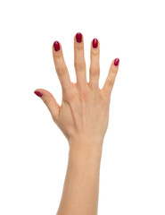 Red manicured female open hand gesture number five fingers up