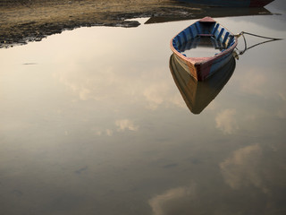 Rowboat Floating on Still Waters