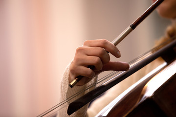 Hand girl playing cello