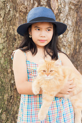 portrait of cute little girl asian and hand hold cat