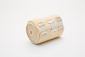 elastic bandage on a roll on white background