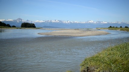 Wilderness scene in Alaska with mountains and river
