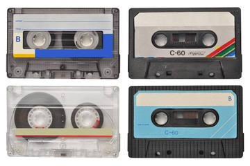 Four retro cassette tapes isolated on white