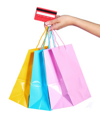 Colorful Shopping Bags and Credit Card in Female Hand isolated