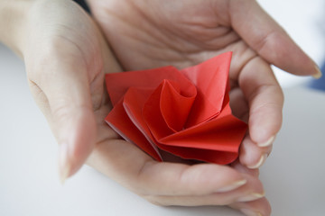 Women who have a rose made with origami