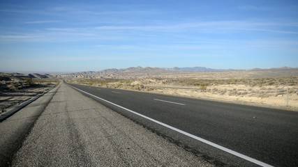 Remote stretch of road on Interstate in Desert and Mountains