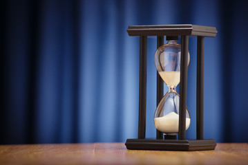 Hourglass on a dark blue background