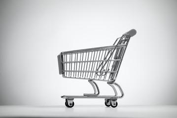 Empty shopping cart on light background.