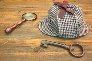 Sherlock Holmes Cap famous as Deerstalker, Old Key and Magnifier