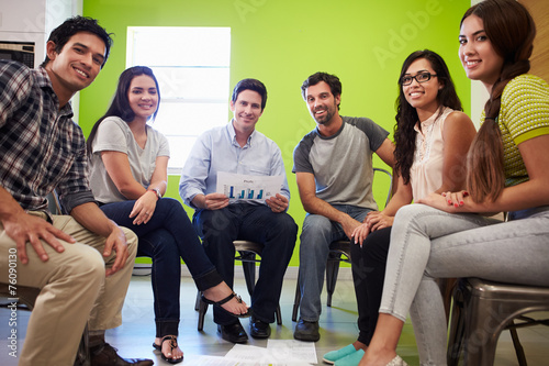 canvas print picture Group Of Hispanic Designers Meeting To Discuss New Ideas
