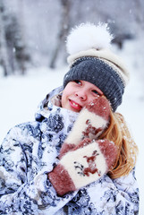 girl in hat and mittens