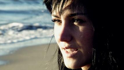 Young woman relaxing looking the ocean closeup