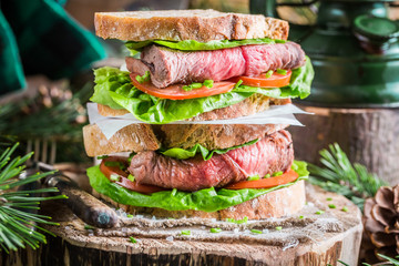 Homemade hamburger with beef, lettuce and tomato