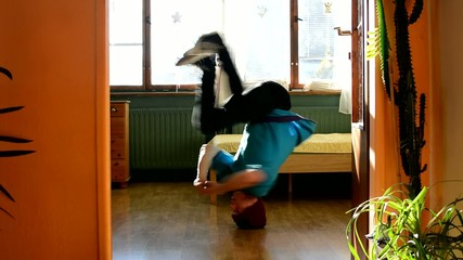 Young breakdancer in the room