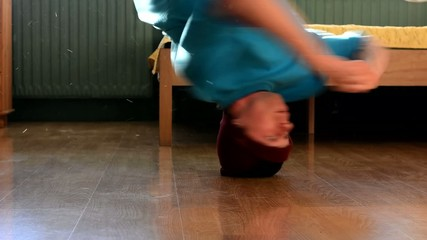 Young breakdancer in the room, close up